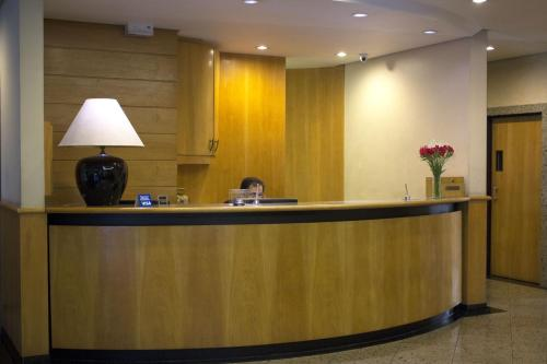 The lobby or reception area at Alameda Apart Hotel