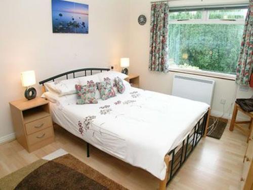 Кровать или кровати в номере Chy-An-Ula - W42461
