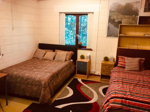 A bed or beds in a room at Positive House
