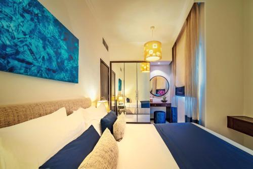 A bed or beds in a room at First Central Hotel Suites