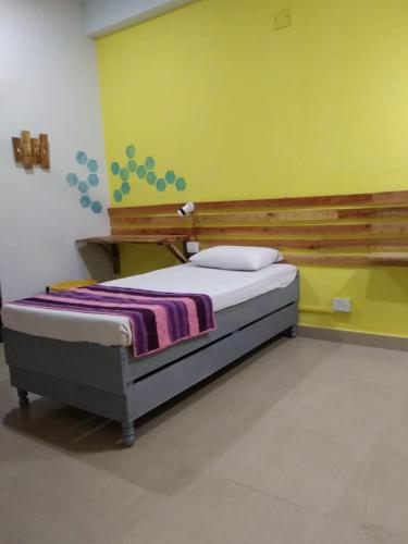A bed or beds in a room at Haveli Hostel