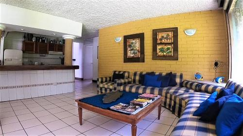 A seating area at Amatitlan Home AM004