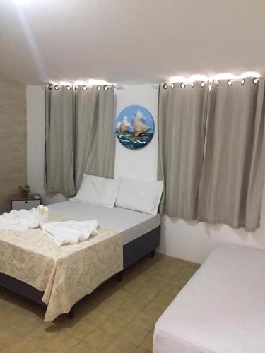 A bed or beds in a room at Pousada Águas Marinhas