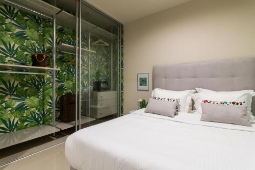 A bed or beds in a room at Athens Mosaico Suites & Apartments