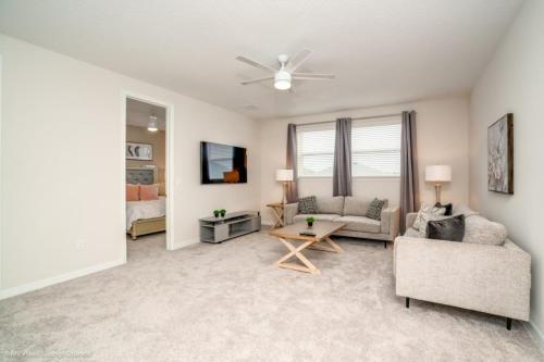 A seating area at 1719Cvt Orlando Newest Resort Community Home Villa