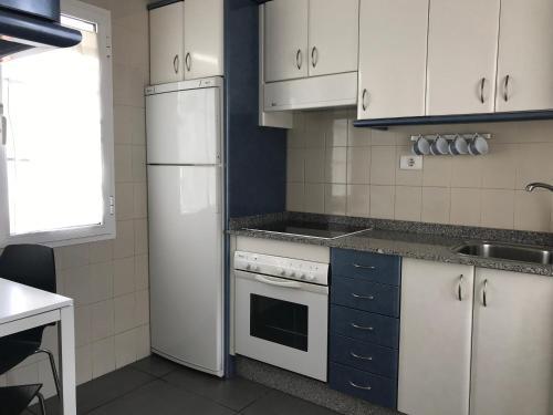 Una cocina o zona de cocina en Apartamento Playa Blanca Holiday