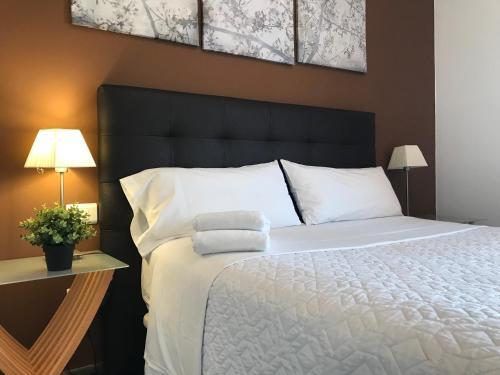 Cama o camas de una habitación en Apartamento Playa Blanca Holiday