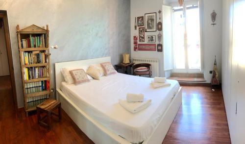Postel nebo postele na pokoji v ubytování House Candia 111 - Vatican Museum apartment