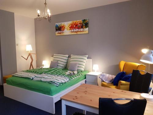Ein Bett oder Betten in einem Zimmer der Unterkunft Apartments Blumenthal