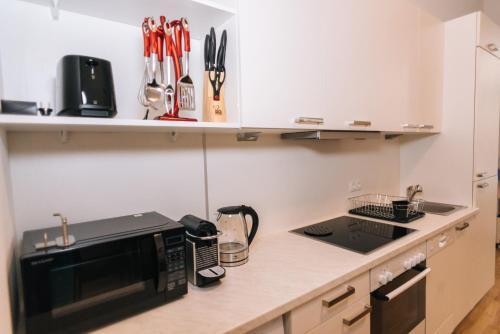 מטבח או מטבחון ב-Amici Apartments Hermine