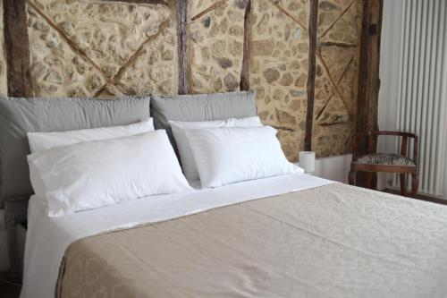 A bed or beds in a room at Dependance delle Grazie