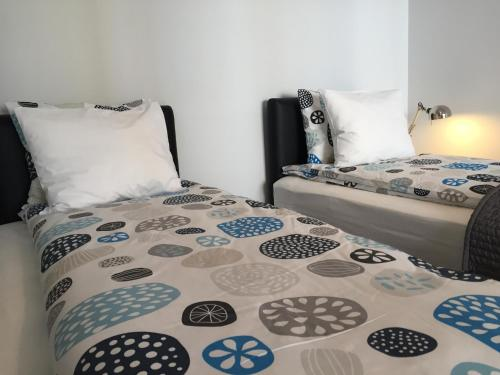 A bed or beds in a room at Marcelin Apartments Poznań