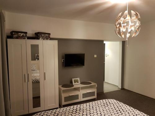 A television and/or entertainment center at Marcos Apartments