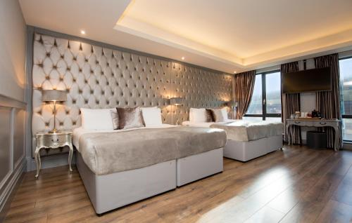 A bed or beds in a room at Signature Living at Shankly Hotel
