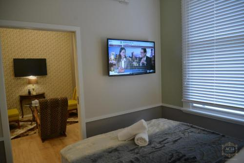 A television and/or entertainment center at Auckland City Hotel - Hobson St