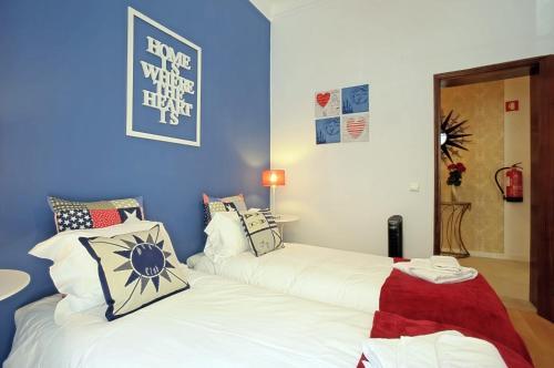 Cama ou camas em um quarto em Localtraveling Alameda City Center