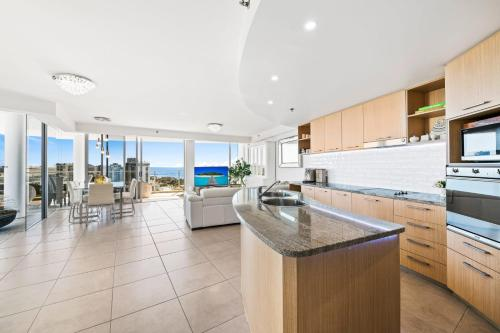 A kitchen or kitchenette at Sanctuary at the Sebel - Penthouse with private Rooftop Lounge