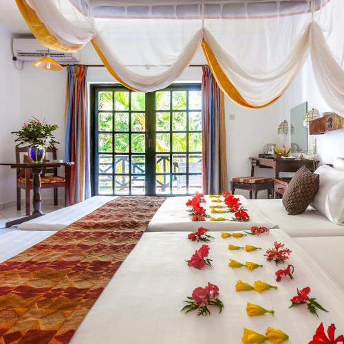 A bed or beds in a room at Diani Sea Resort - All Inclusive