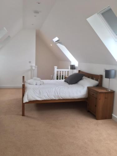 A bed or beds in a room at Tidemill House 5b Apartment