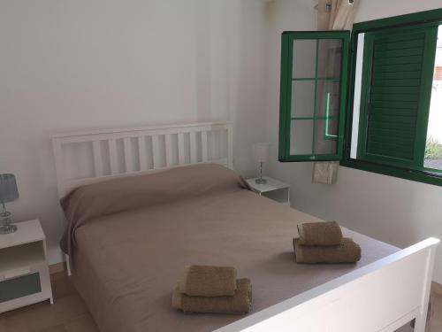 A bed or beds in a room at Caleta de Fuste Luxury Apartment