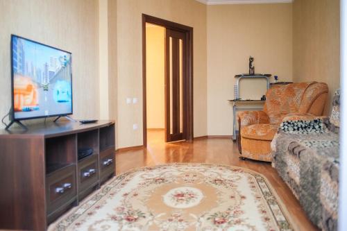 Телевизия и/или развлекателен център в Апартаменты