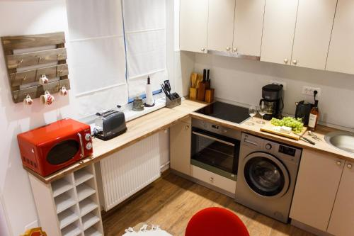 A kitchen or kitchenette at Grand Accommodation Apartments