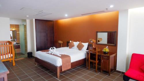 A bed or beds in a room at Ananas Family Hotel