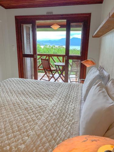 Cama ou camas em um quarto em Pousada Naturalia