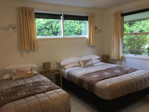 A bed or beds in a room at Aoraki Alpine Chalet