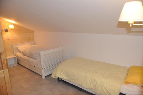 Ένα ή περισσότερα κρεβάτια σε δωμάτιο στο Chalet L'Establou
