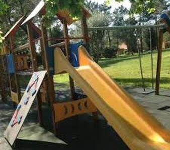 Zona de juegos infantil en Apartamento 4 - Golf