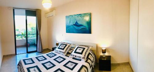 A bed or beds in a room at Chez Amy et Yaya - Terrasses de l'Océan