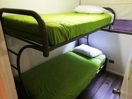 Litera o literas de una habitación en Santiago Town Suites