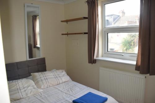 St Andrews房間的床