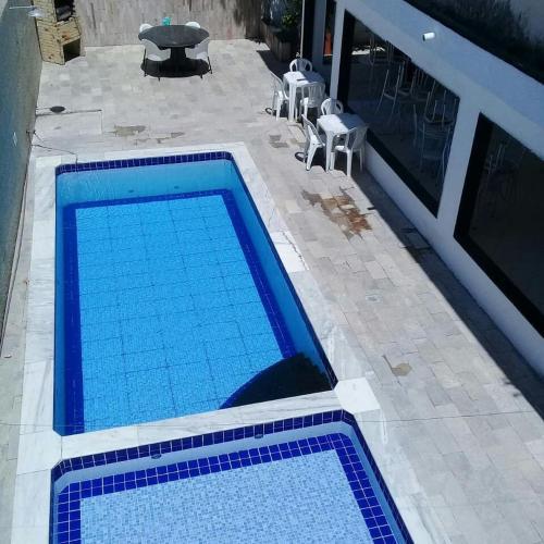 Uma vista da piscina em Pousada Águas de Mar ou nos arredores