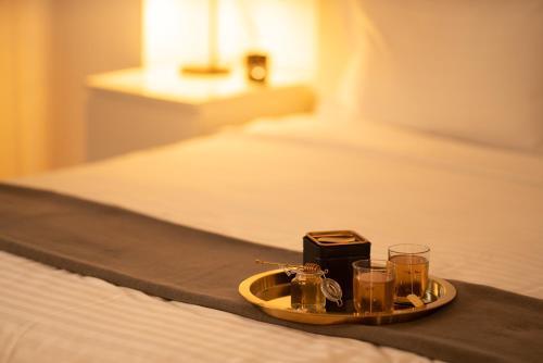 Un pat sau paturi într-o cameră la ZEN Apartments Cluj