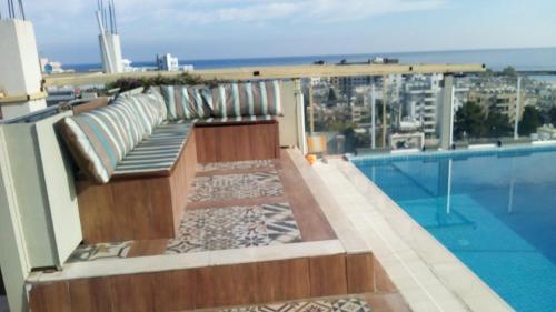 The swimming pool at or near Aqua Royal residence