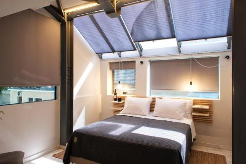 A bed or beds in a room at Caravel Voyage Suites by Living-Space