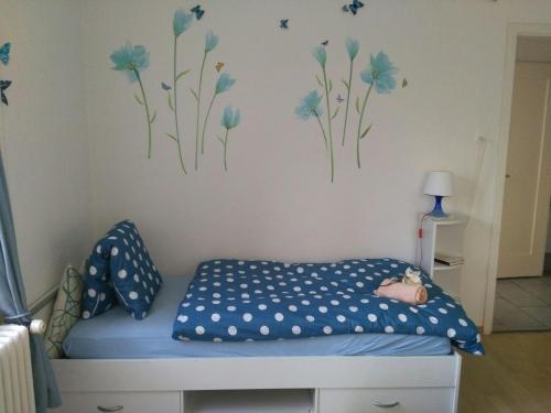 Ein Bett oder Betten in einem Zimmer der Unterkunft Calm Family Apartment