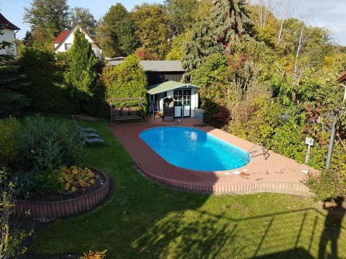 The swimming pool at or near Villa Harzblick