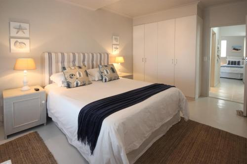 A bed or beds in a room at The Potting Shed Self Catering