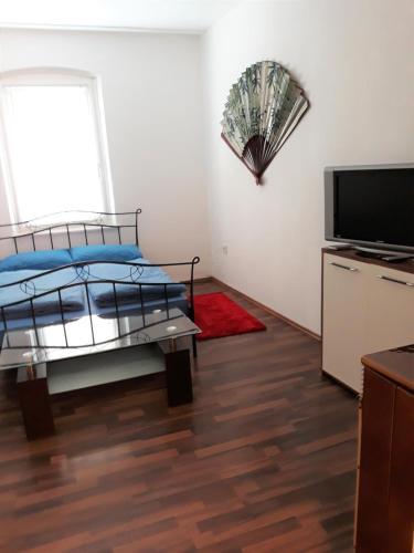 Ein Bett oder Betten in einem Zimmer der Unterkunft Diana Appartement