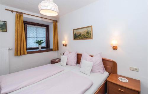 A bed or beds in a room at Apartment Marktstrasse