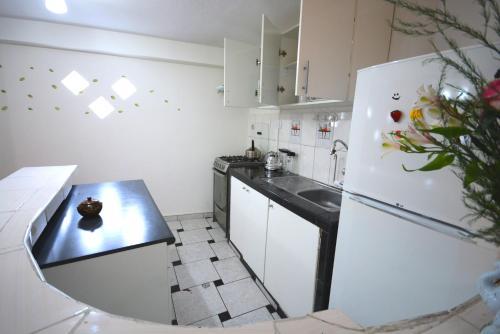 Una cocina o zona de cocina en Cusqueñita 3