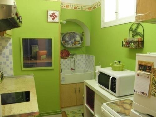 A kitchen or kitchenette at Rental Apartment Eskualduna 53 - Hendaye