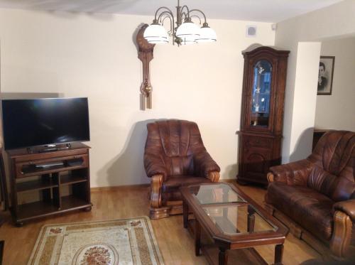 A seating area at Ac Apartament Czestochowa