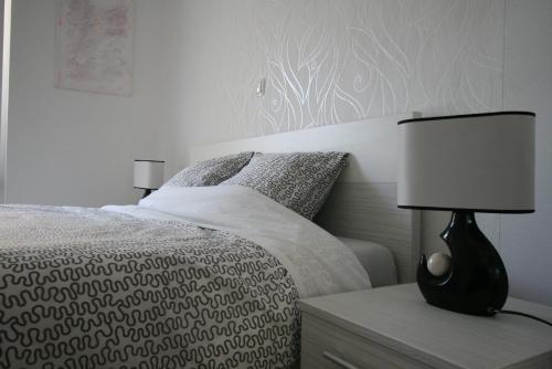 Krevet ili kreveti u jedinici u objektu Apartments Mali Nono