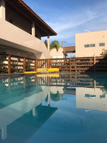 A piscina localizada em Pousada Rosa Karioka ou nos arredores