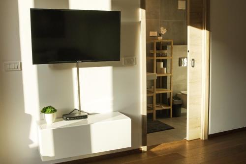 TV in/ali zabaviščno središče v nastanitvi Ski and Bike Apartment Rušovc