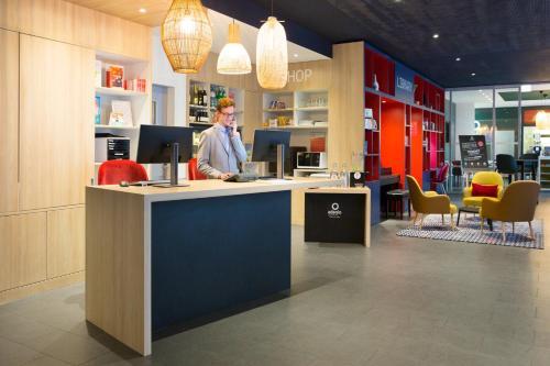 The lobby or reception area at Aparthotel Adagio Basel City